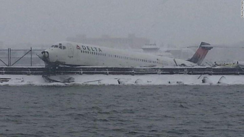 Plane skids off runway, stops feet from water's edge