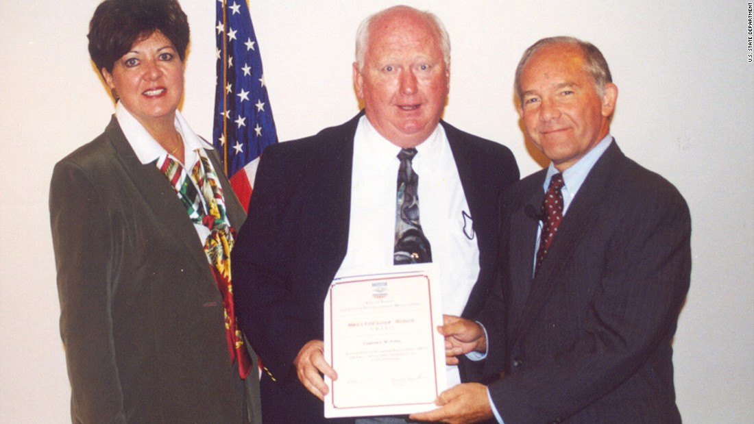 Laurence Foley, an employee of the U.S. Agency for International Development, receives an achievement award from U.S. Ambassador to Jordan Edward Gnehm, right, and USAID Mission Director Toni Christiansen-Wagner in October 2002. Two months later, Foley was shot dead by a lone gunman outside his home in Amman, Jordan.