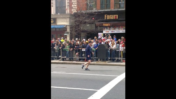 Eight-year-old Martin Richard, the youngest victim, can be seen standing on the rail in the front row.