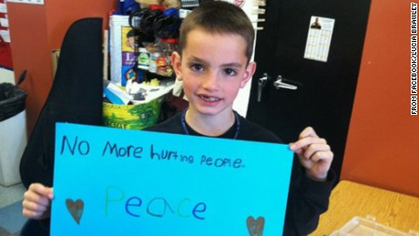 An image taken from Facebook shows Martin Richard, the 8-year-old killed during the explostions at the Boston Marathon, holding a shign calling for peace.