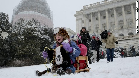 Claire McKeon, left, and Megan Krepp, right, sled on the west lawn of the U.S. Capitol during a snow storm in Washington, DC. on March 5.