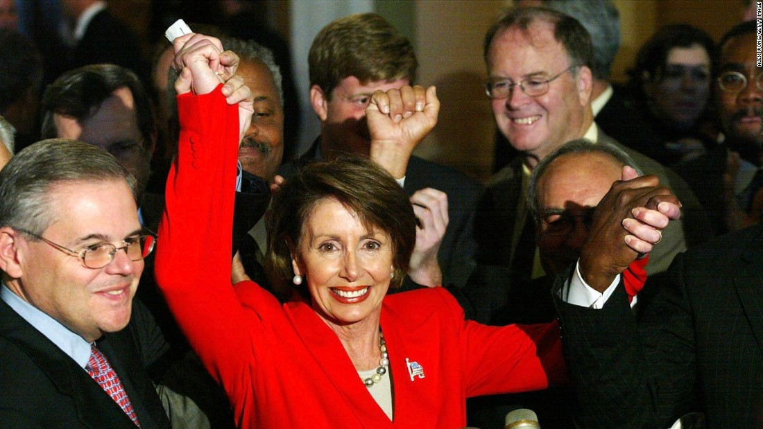 Newly elected House Minority Leader Rep. Nancy Pelosi (D-CA) (second left) joins hands with fellow Democratic Rep. Robert Menendez (D-NJ) (left) and Rep. James Clyburn (D-SC) (right) to celebrate Pelosi's victory to be the new House minority leader for the 108th Congress on November 14, 2002.