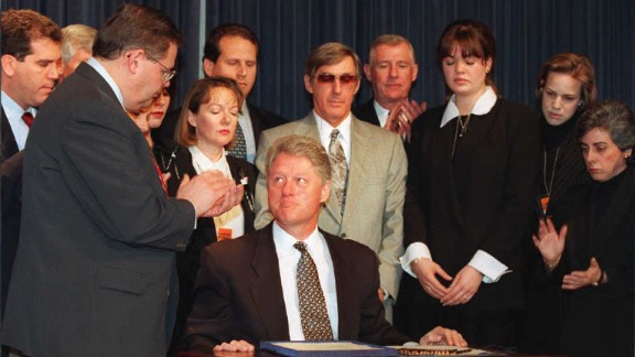 President Bill Clinton (center-seated) looks up after signing a bill into law which is designed to tighten the U.S. embargo on Cuba during ceremonies on March 12, 1996 at the White House in Washington, D.C.