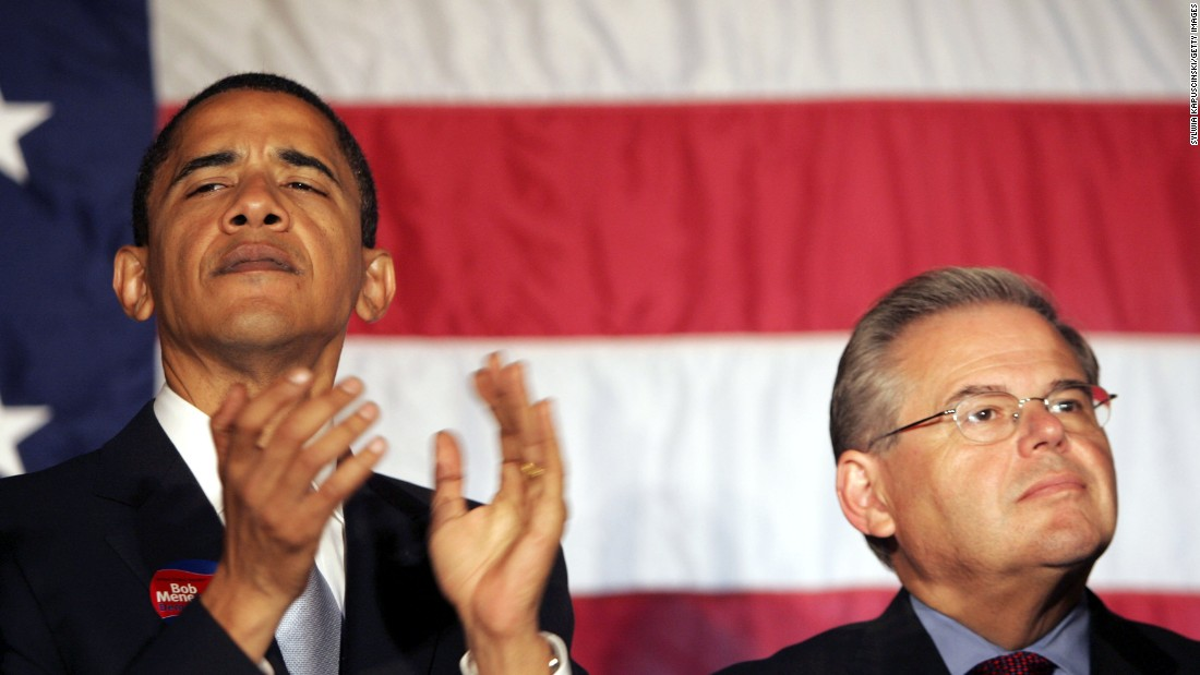 Barack Obama and Robert Menendez listen to New Jersey Governor Jon Corzine at a rally for Menendez October 12, 2006 at the Masonic Temple in Trenton, New Jersey.