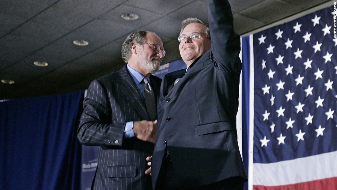 Sen. Robert Menendez (D-NJ) waves to the crowd with New Jersey Gov. Jon Corzine at his side at election night headquarters after Menendez defeated Republican challenger Thomas Kean Jr., November 7, 2006 in East Brunswick, New Jersey.