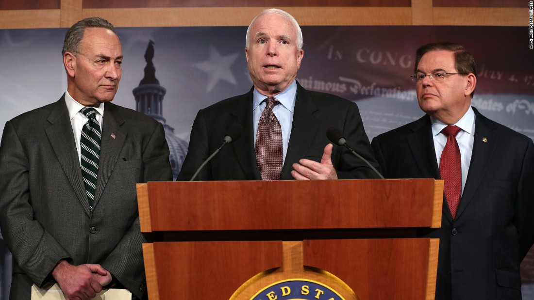 Sen. John McCain (R-AZ) (center) speaks as Sen. Charles Schumer (D-NY) (left) and Sen. Robert Menendez (D-NJ) (right) listen during a news conference on a comprehensive immigration reform framework January 28, 2013 on Capitol Hill in Washington.