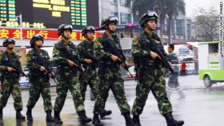 Armed Chinese paramilitary policemen patrol  Guangzhou Railway Station after knife-wielding assailants attacked people on March 6, 2015.