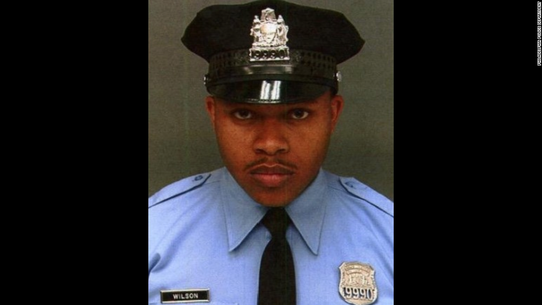 "Philadelphia Police Officer Robert Wilson III was buying a gift for his son on March 5 when two men held up the store where he was shopping. Wilson, who was in uniform, <a href=""http://www.cnn.com/2015/03/07/us/philadelphia-policeman-killed/"" target=""_blank"">confronted the men</a> and a firefight broke out. Wilson, 30, was shot and killed. Police said security footage showed the eight-year veteran stepping away from the store's patrons and employees to keep them out of the crossfire."
