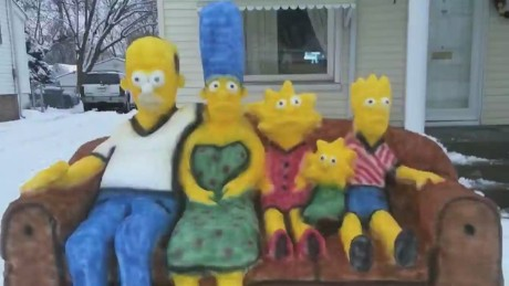 Family builds snow sculpture of 'The Simpsons'