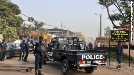 Police block the street near the site of Saturday's deadly shooting in Bamako, Mali.