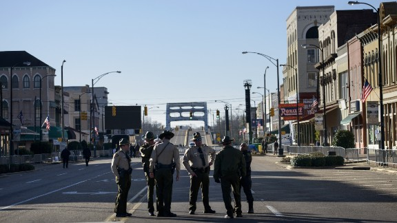Police officers block Broad Street near the Edmund Pettus Bridge.