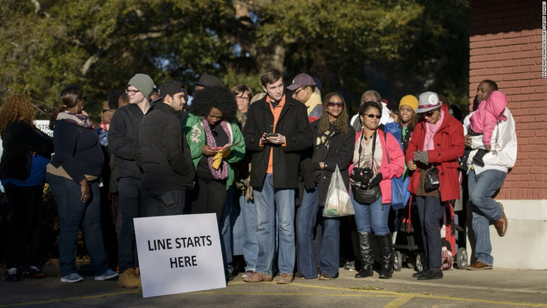 People wait in line to attend an anniversary event, where President Obama is scheduled to speak, at the Edmund Pettus Bridge.