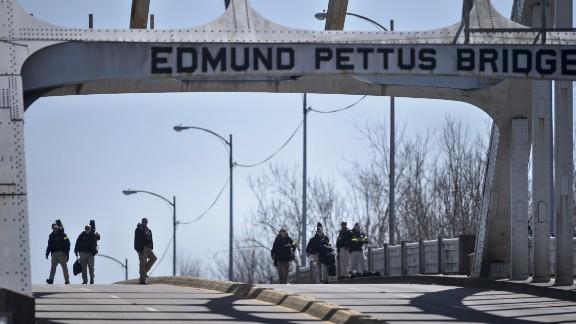 U.S. Secret Service snipers inspect the Edmund Pettus Bridge.