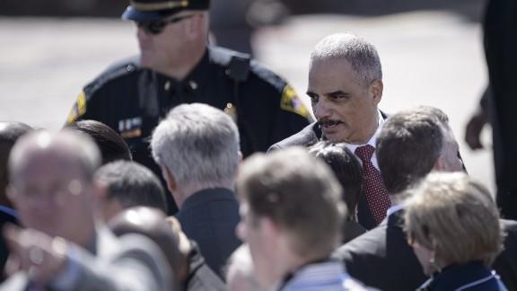 U.S. Attorney General Eric H. Holder Jr. arrives at the Edmund Pettus Bridge.