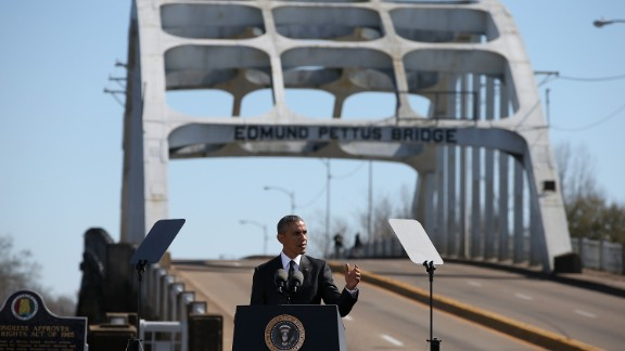 """President Barack Obama speaks in front of the Edmund Pettus Bridge during ceremonies commemorating the """"Bloody Sunday"""" confrontation between civil rights marchers and state troopers at the bridge 50 years ago."""