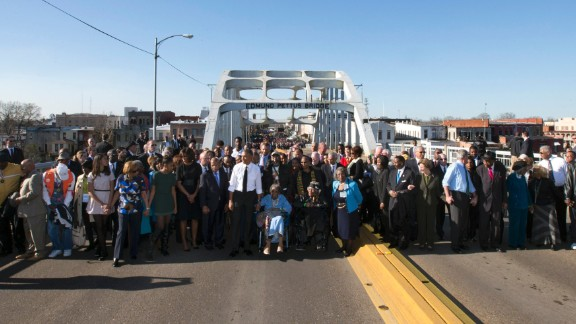 President Barack Obama, first lady Michelle Obama, and daughters Malia and Sasha as well as members of Congress, civil rights leaders and others make a symbolic walk across the bridge on Saturday, March 7, 2015.