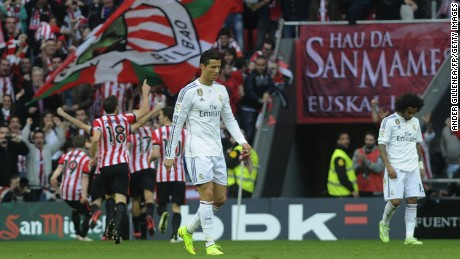 A gloomy Cristiano Ronaldo (center) looks away as Athletic Bilbao players celebrate during its 1-0 victory over Real Madrid.