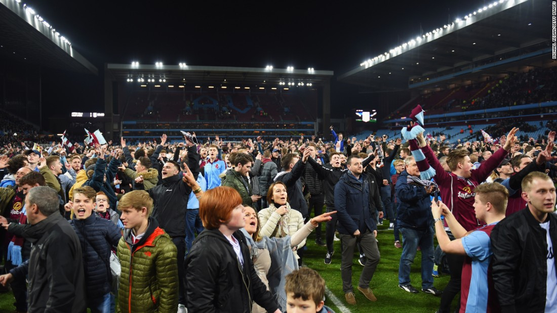 Jubilant Aston Villa fans invaded the pitch to celebrate their team's 2-0 English FA Cup quarterfinal victory over local rivals West Bromwich Albion Saturday.