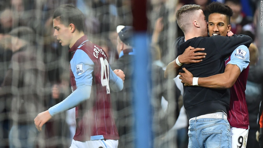 A sole fan runs on to congratulate Villa striker Scott Sinclair after he made it 2-0 to the home side late in the second period.