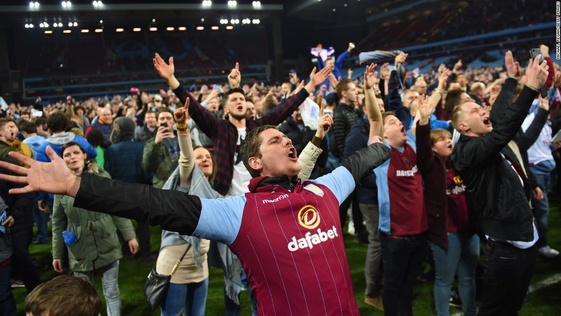 Thousands of Aston Villa fans celebrate on the turf of Villa Park at the fulltime whistle. Their side will now travel to Wembley for the FA Cup semifinals next month.