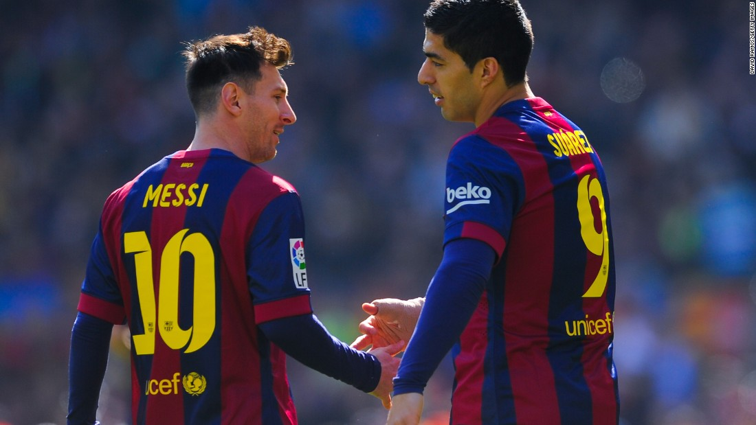 Luis Suarez (right) celebrates with Lionel Messi after scoring Barcelona's opening goal in the 6-1 win at home to Rayo Vallecano on March 8.