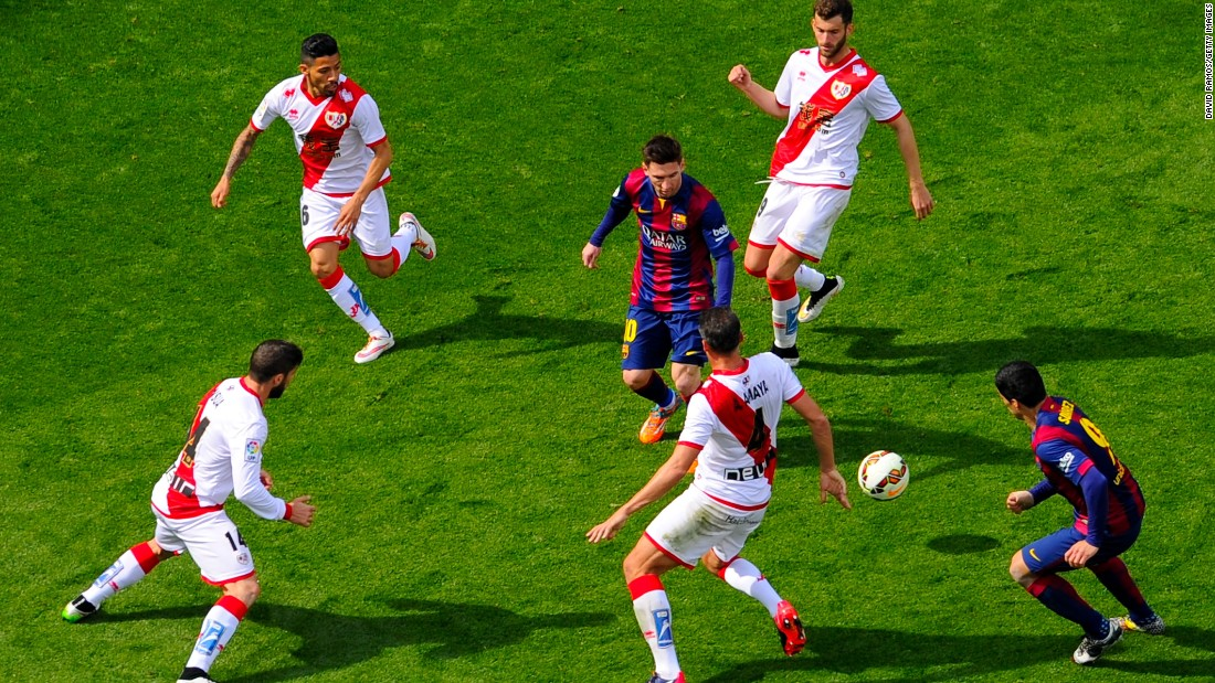 Messi was surrounded by Rayo Vallecano players in this La Liga match, but still managed the 32nd hat-trick of his career as Barca romped to a 6-1 win.