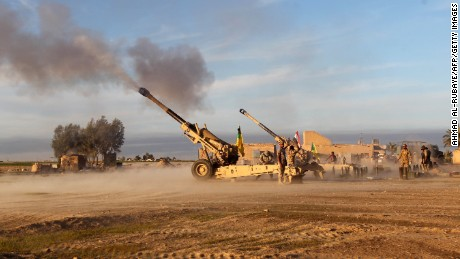 The Shiite fighters fire Howitzer Cannons towards positions on Saturday, March 7 on the outskirts of  Ad-Dawr, Iraq.