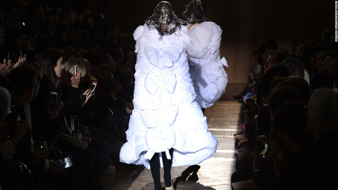 "Rei Kawakubo's show, titled ""Ceremony of Seperation,"" conveyed a sense of isolation and loss."