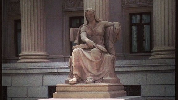 """""""The Future"""" sits in front of the National Archives and is a 1935 Robert Aitken sculpture of a woman seated, holding an open book, over the inscription, """"What is Past is Prologue."""""""