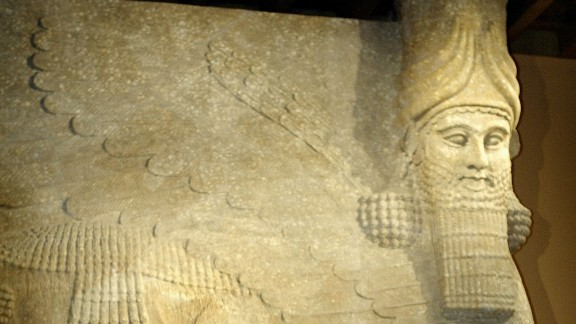 Caption:CHICAGO, IL -SEPTEMBER 29: Standing in front of a colossal human-headed winged bull which once stood at the entrance of the throne room of King Sargon II (721-705 BC) in Khorsabad, capital of Assyria, Donny George, General Director for Research with the Iraq State Board of Antiquities in Baghdad, answers questions during a news conference at the University of Chicago's Oriental Institute September 29, 2003 in Chicago, Illinois. George was at the university to discuss the latest information on lost and endangered artifacts in Iraq. (Photo by Scott Olson/Getty Images)