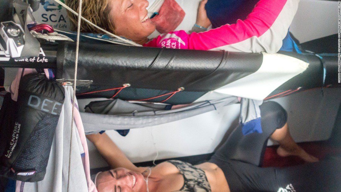 The competition includes one all-female team -- SCA -- who have 11 sailors on board. All other teams have eight sailors. Here, members of the women's crew strap themselves into bunks during a sleeping shift.