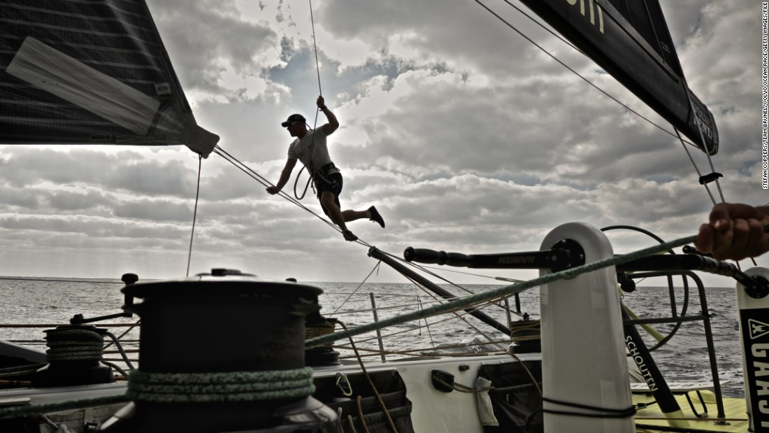 Sailor Gerd-Jan Poortman shows off his acrobatic skills as he makes adjustments to the clew during Leg 3 between the United Arab Emirates and China.