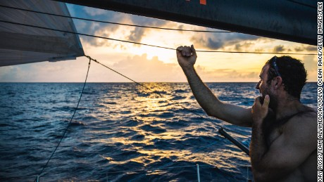 Sailor Seb Marsset looks across the ocean. Over the equator and into the Southern Hemisphere, the weather turns tropical, with rainclouds driving much of the day's movement south towards Vanuatu.