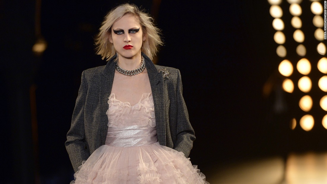 Hedi Slimane showed another rock 'n' roll collection heavy on mini dresses, sharp-shouldered blazers, leather, and black.