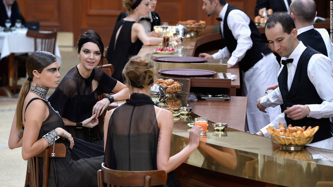 At Chanel, models stopped for a drink at Brasserie Gabrielle, the elaborate set made to look like an elegant Parisian restaurant.