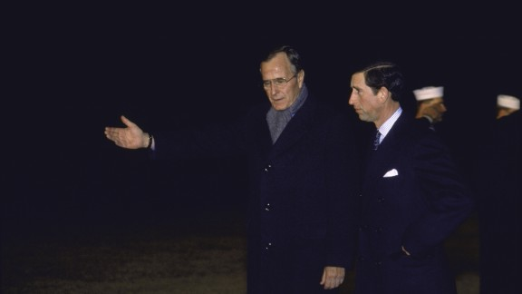 President George H.W. Bush greets Prince Charles in 1990.