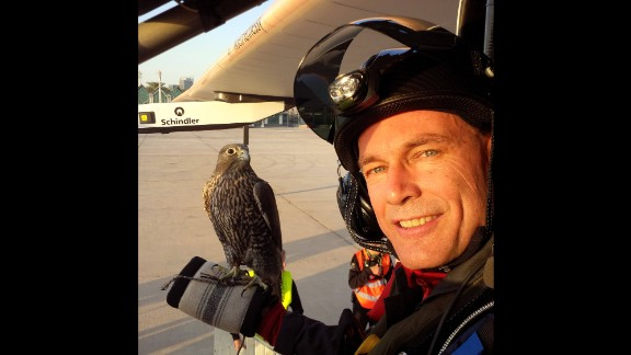 Pilot Bertrand Piccard takes a selfie with a falcon Thursday, March 5, in Abu Dhabi, United Arab Emirates. Piccard and Andre Borschberg are attempting to become the first people to fly around the world on a solar-powered plane.
