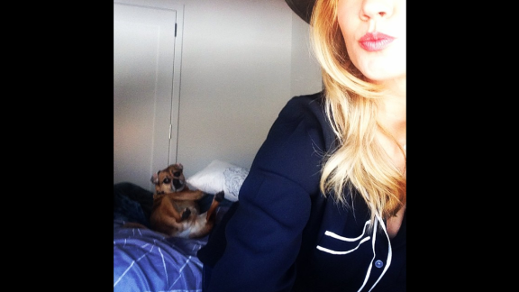 """This guy kills me. Photo bombed by #rockythepuggle,"" actress Anna Camp said on Saturday, March 7."