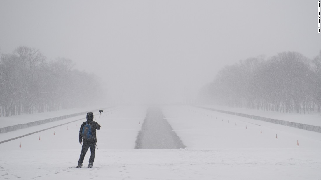A man uses a selfie stick on the National Mall during a heavy snowstorm in Washington on Thursday, March 5.