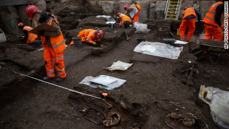 Archaeologists excavate the 16th and 17th century Bedlam burial ground uncovered by work on the new Crossrail train line next to Liverpool Street station in London, Friday, March 6, 2015. The excavation team estimate there to be 3,000 human skeletons at the site, which was a burial ground to the then adjacent Bedlam Hospital, the world's first psychiatric asylum. The 118-kilometer (73-mile) Crossrail project to put a new rail line from west to east London is Britain's biggest construction project and the largest archeological dig in London for decades.