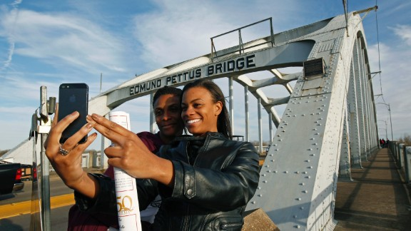 "Lazette Bowens, left, and her daughter Zoe take a selfie at the Edmund Pettus Bridge in Selma, Alabama, on Friday, March 6. Fifty years ago, state troopers used brutal force and tear gas at the bridge to push back hundreds of people marching to protest discriminatory practices. What the marchers did years ago ""will reverberate through the ages,"" President Obama said on Saturday, March 7. ""Not because the change they won was preordained; not because their victory was complete; but because they proved that nonviolent change is possible; that love and hope can conquer hate."""