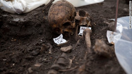 Two adult skulls lie next to each other on the archeological excavation site at the 16th and 17th century Bedlam burial ground, uncovered by work on the new Crossrail train line next to Liverpool Street station in London, Friday, March 6, 2015. The excavation team estimate there to be 3,000 human skeletons at the site, which was a burial ground to the then adjacent Bedlam Hospital, the world's first psychiatric asylum. The 118-kilometer (73-mile) Crossrail project to put a new rail line from west to east London is Britain's biggest construction project and the largest archeological dig in London for decades