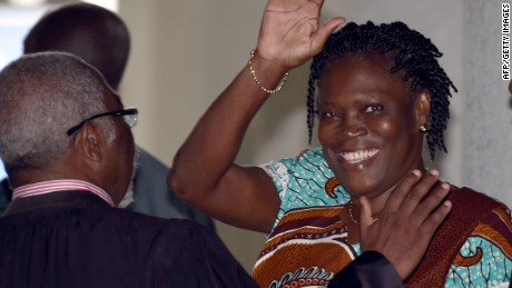 "(FILES) A file photo taken on February 23, 2015 shows former Ivorian first lady Simone Gbagbo waving as she arrives at the Court of Justice in Abidjan, for her trial along with others for ""attempting to undermine the security of the state"" in events leading to a bloody 2010-2011 post electoral crisis that left thousands dead. Gbagbo was sentenced on March 10 to a 20-year prison term. Once referred to by admirers and opponents alike as Ivory Coast's ""Iron Lady, "" Gbagbo has been on trial since January with 82 co-defendants accused of varying degrees of involvement in the deadly unrest. AFP PHOTO / ISSOUF SANOGOISSOUF SANOGO/AFP/Getty Images"