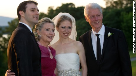 In this handout image provided by Barbara Kinney, (L-R) Marc Mezvinsky, U.S. Secretary of State Hillary Clinton, Chelsea Clinton and former U.S. President Bill Clinton pose during the wedding of Chelsea Clinton and Marc Mezvinsky at the Astor Courts Estate on July 31, 2010 in Rhinebeck, New York.