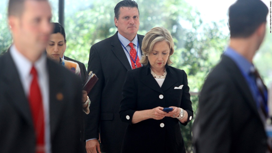 Clinton looks at her phone after attending a Russia-U.S. meeting in Hanoi, Vietnam, in July 2010.