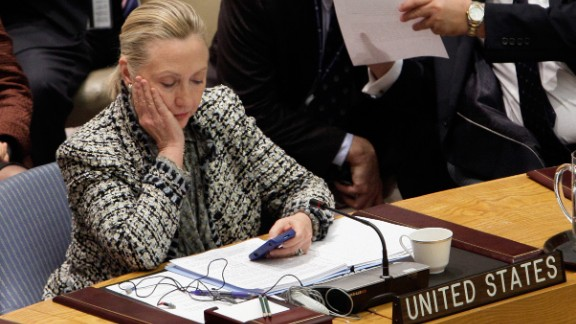 Clinton checks her phone after addressing the U.N. Security Council in March 2012.