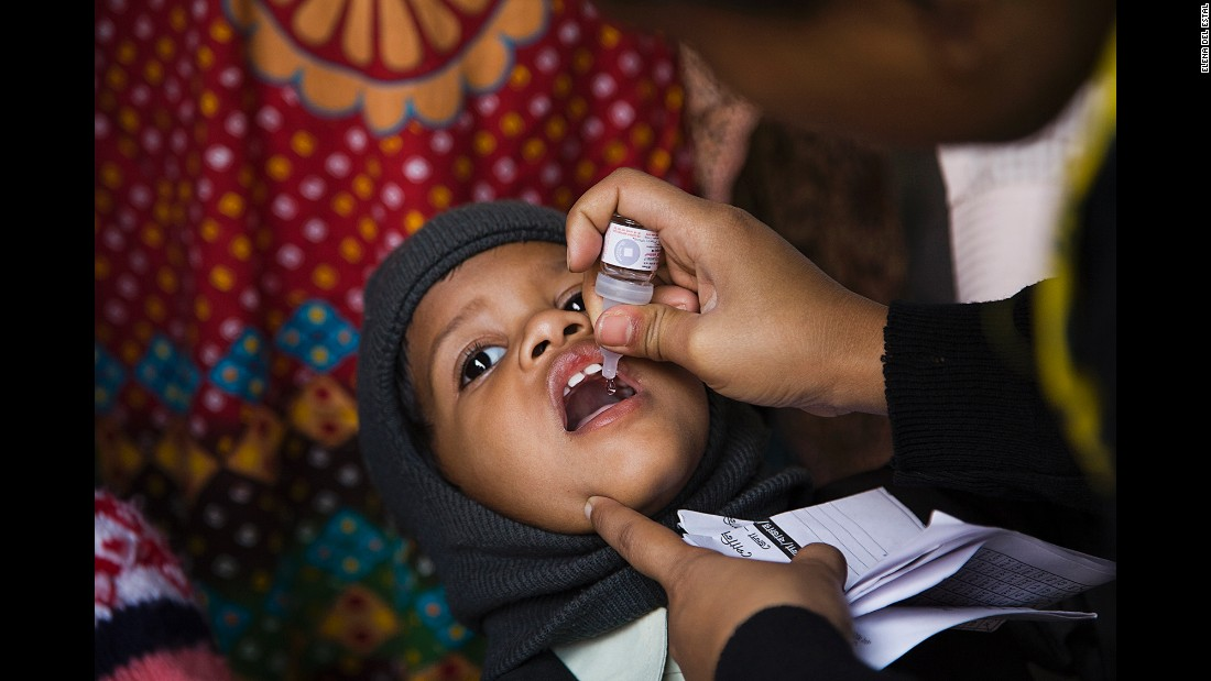 A child is vaccinated at a train station in Kolkata, India, in January 2014. Transit stations have been key points for the Pulse Polio immunization program.