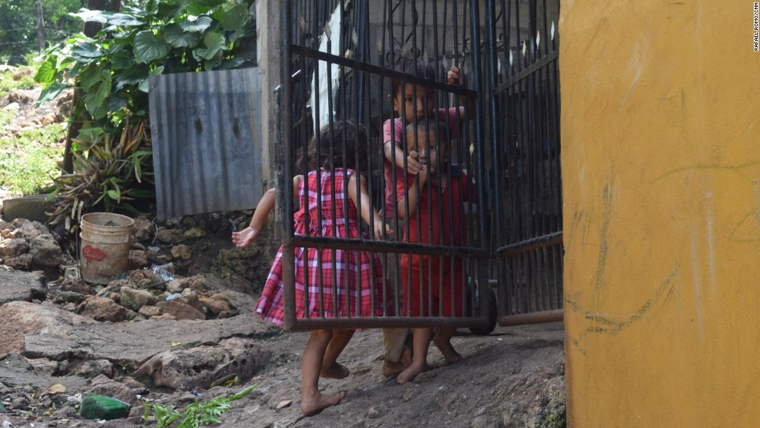 Guatemalan children play outside their home in El Ceibo, a town across the border from Mexico in the Petén province.