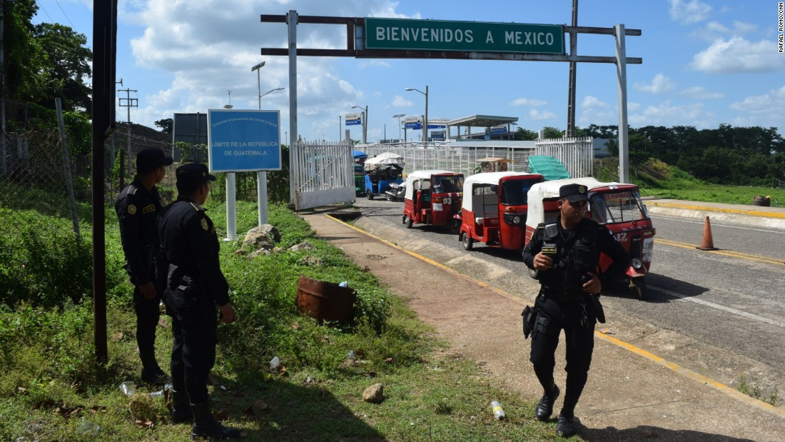 Police patrol the Mexico-Guatemala border in the Guatemalan town of El Ceibo.