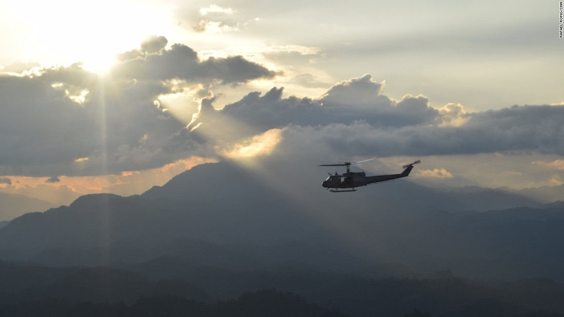 A Guatemalan National Civil Police helicopter approaches the Guatemalan Air Force base at La Aurora International Airport in Guatemala City.
